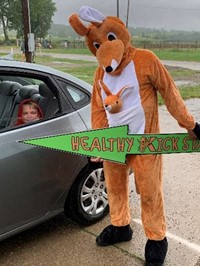costumed kangaroo and student in a car