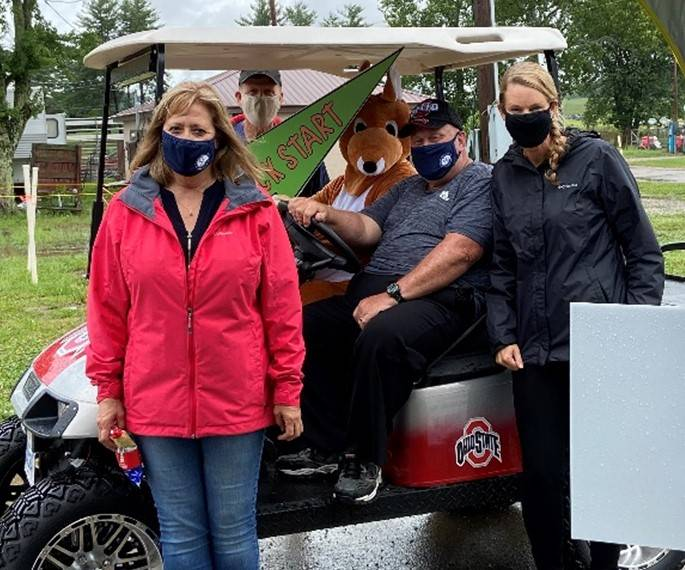 3 adults and a costumed kangaroo in a golf cart